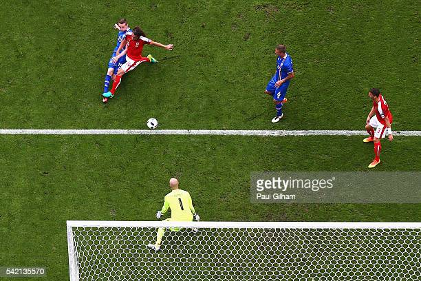 Jon Dadi Bodvarsson of Iceland scores hios team's first goal despte pressure from Julian Baumgartlinger of Austria during the UEFA EURO 2016 Group F...