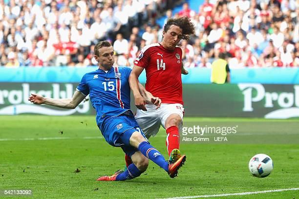 Jon Dadi Bodvarsson of Iceland scores his team's first goal despite the challenge of Julian Baumgartlinger of Austria during the UEFA EURO 2016 Group...