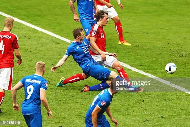 Jon Dadi Bodvarsson of Iceland scores his team's first goal despte the challenge of Julian Baumgartlinger of Austria during the UEFA EURO 2016 Group...