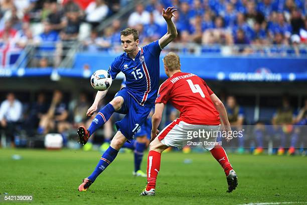 Jon Dadi Bodvarsson of Iceland takes on Martin Hinteregger of Austria during the UEFA EURO 2016 Group F match between Iceland and Austria at Stade de...