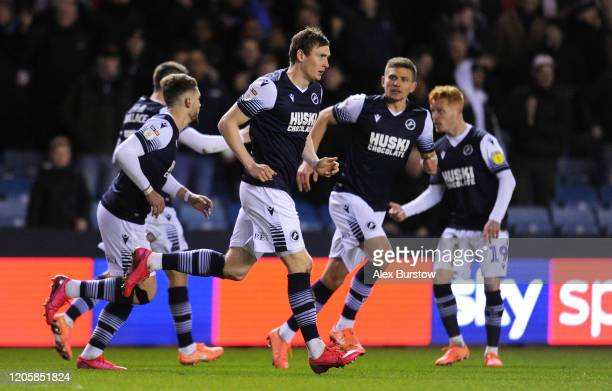 Jon Dadi Bodvarsson of Millwall celebrates with teammates after scoring his team's first goal during the Sky Bet Championship match between Millwall...