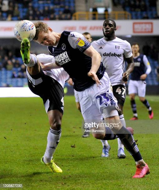 Jon Dadi Bodvarsson of Millwall is challenged by Denis Odoi of Fulham during the Sky Bet Championship match between Millwall and Fulham at The Den on...