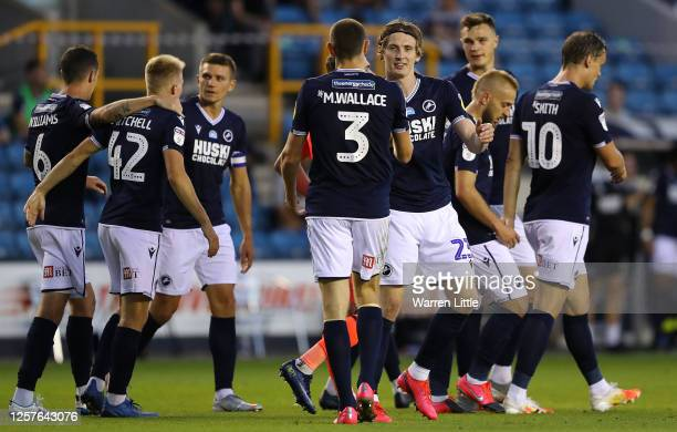 Jon Dadi Bodvarsson of Millwall is congratulated after scoring the fourth goal during the Sky Bet Championship match between Millwall and...