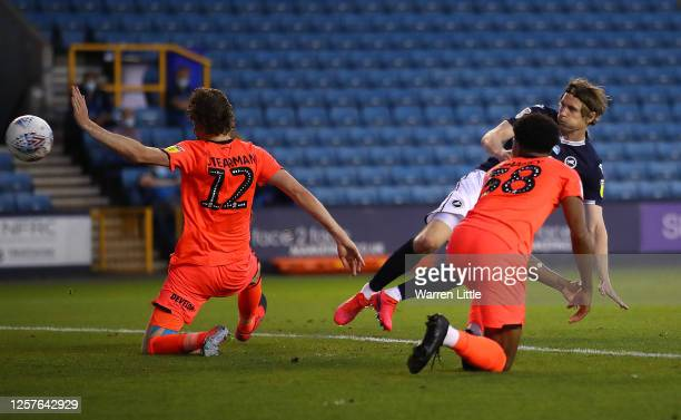 Jon Dadi Bodvarsson of Millwall scores the fourth goal during the Sky Bet Championship match between Millwall and Huddersfield Town at The Den on...