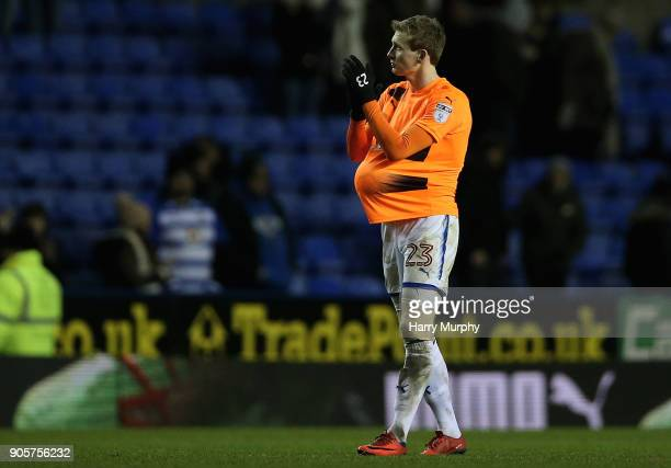 Jon Dadi Bodvarsson of Reading applauds fans with his hattrick ball under his shirt after the Emirates FA Cup Third Round Replay match between...