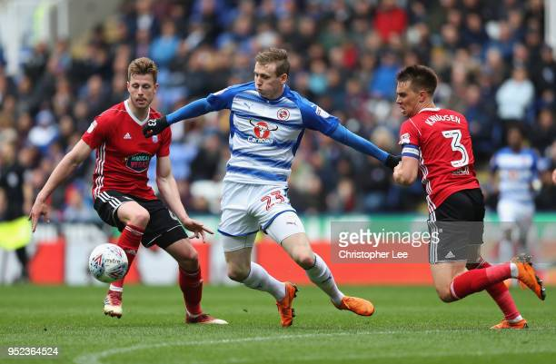 Jon Dadi Bodvarsson of Reading battles with Adam webster and Jonas Knudsen of Ipswich during the Sky Bet Championship match between Reading and...