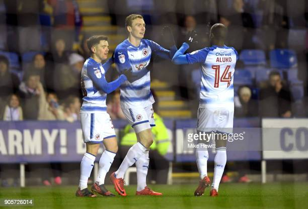 Jon Dadi Bodvarsson of Reading celebrates as he scores their first goal with team mates during The Emirates FA Cup Third Round Replay match between...