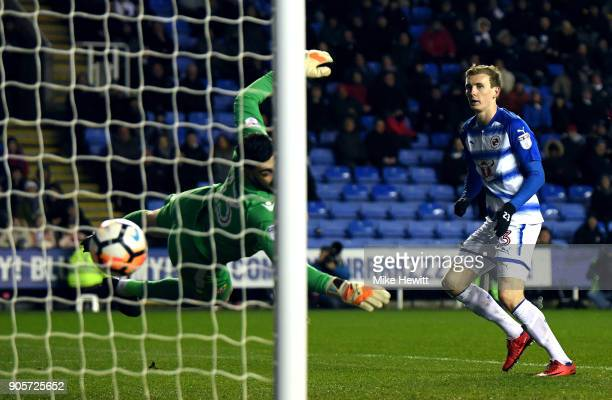Jon Dadi Bodvarsson of Reading shoots past Tom King of Stevenage to score their first goal during The Emirates FA Cup Third Round Replay match...