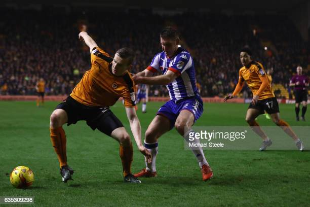 Jon Dadi Bodvarsson of Wolverhampton is tracked by Jake Buxton of Wigan during the Sky Bet Championship match between Wolverhampton Wanderers and...