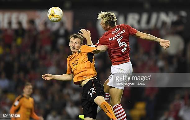 Jon Dadi Bodvarsson of Wolverhampton Wanderers and Angus MacDonald of Barnsley during the Sky Bet Championship match between Wolverhampton Wanderers...