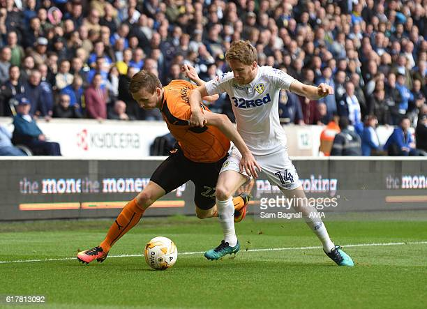 Jon Dadi Bodvarsson of Wolverhampton Wanderers and Eunan O'Kane of Leeds United during the Sky Bet Championship match between Wolverhampton Wanderers...