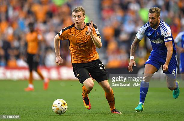 Jon Dadi Bodvarsson of Wolverhampton Wanderers and Luke Chambers of Ipswich Town during the Sky Bet Championship match between Wolverhampton...