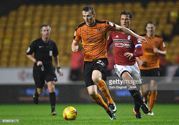 Jon Dadi Bodvarsson of Wolverhampton Wanderers and Scott Parker of Fulham during the Sky Bet Championship match between Wolverhampton Wanderers and...