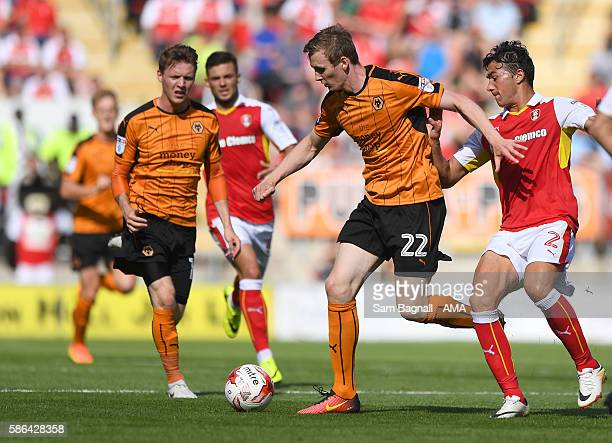 Jon Dadi Bodvarsson of Wolverhampton Wanderers and Stephen Kelly of Rotherham United during the Sky Bet Championship match between Rotherham United v...