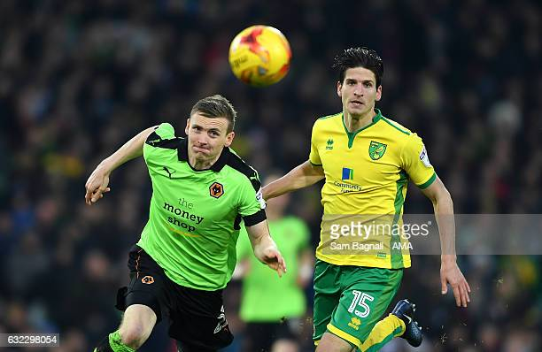 Jon Dadi Bodvarsson of Wolverhampton Wanderers and Timm Klose of Norwich City during the Sky Bet Championship match between Norwich City and...