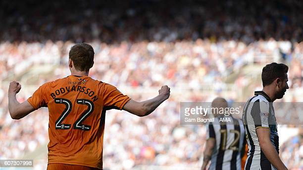 Jon Dadi Bodvarsson of Wolverhampton Wanderers celebrates after Chancel Mbemba of Newcastle United scored an own goal to make it 01 during the Sky...
