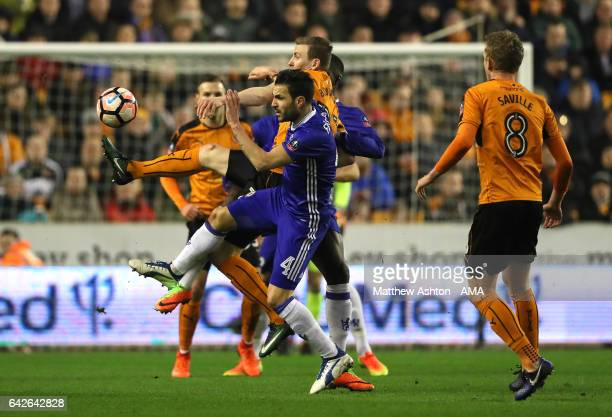 Jon Dadi Bodvarsson of Wolverhampton Wanderers competes with Cesc Fabregas of Chelsea during the Emirates FA Cup Fifth Round match between...