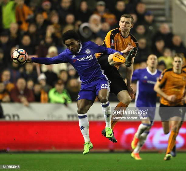 Jon Dadi Bodvarsson of Wolverhampton Wanderers competes with Willian of Chelsea during the Emirates FA Cup Fifth Round match between Wolverhampton...
