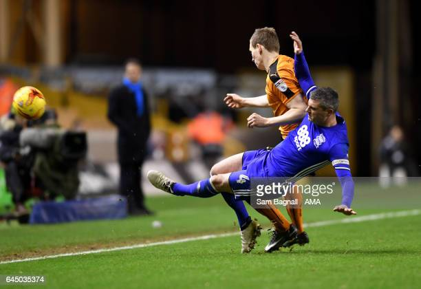Jon Dadi Bodvarsson of Wolverhampton Wanderers is tackled by Paul Robinson of Birmingham City during the Sky Bet Championship match between...