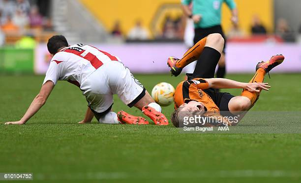 Jon Dadi Bodvarsson of Wolverhampton Wanderers rolls over in pain after a tackle by John Egan of Brentford during the Sky Bet Championship match...