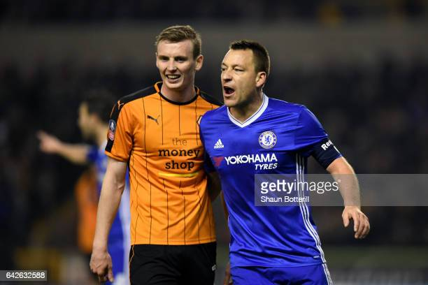 Jon Dadi Bodvarsson of Wolves and John Terry of Chelsea exchange words during The Emirates FA Cup Fifth Round match between Wolverhampton Wanderers...
