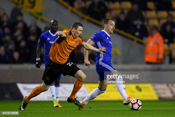 Jon Dadi Bodvarsson of Wolves puts pressure on John Terry of Chelsea during The Emirates FA Cup Fifth Round match between Wolverhampton Wanderers and...