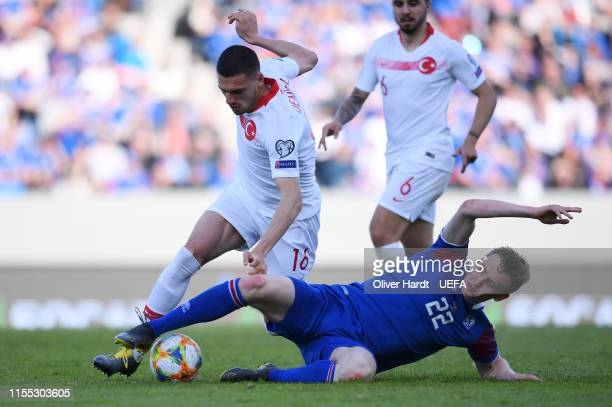 Jon Dadi Boedvarsson of Iceland challenges for the ball with Merih Demiral of Turkey during the UEFA Euro 2020 Qualifier match between Iceland and...