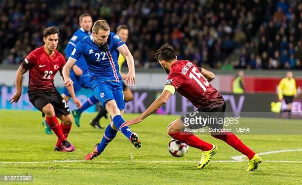 Jon Dadi Boedvarsson of Iceland challenges Mehmet Topal of Turkey during the FIFA 2018 World Cup Qualifier between Iceland and Turkey at...