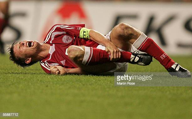 Jon Dahl Thomasson of Denmark is injured after a foul during the FIFA World Cup 2006 Group 2 Qualifier match between Denmark and Greece at the Parken...