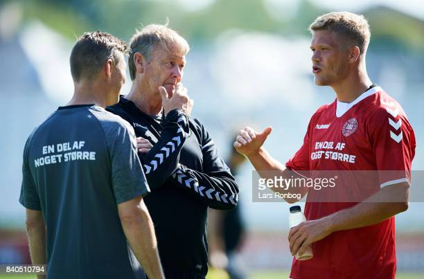Jon Dahl Tomasson assistant coach of Denmark Age Hareide head coach of Denmark and Andreas Cornelius speaking after the Denmark training session at...