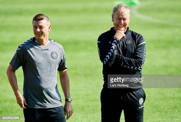 Jon Dahl Tomasson assistant coach of Denmark and Age Hareide head coach of Denmark during the Denmark training session at Helsingor Stadion on August...