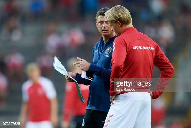 Jon Dahl Tomasson assistant coach of Denmark speaks to Kasper Dolberg of Denmark during halftime in the international friendly match between Denmark...