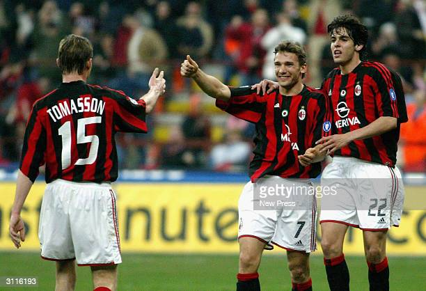 Jon Dahl Tomasson celebrates with teammates Andriy Shevchenko and Ricardo Kaka of Milan during the Serie A match between AC Milan and Parma held at...