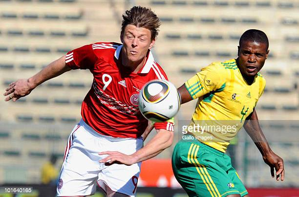 Jon Dahl Tomasson of Denmark and Aaron Mokoena South Africa battle for the ball during the International friendly match between South Africa and...