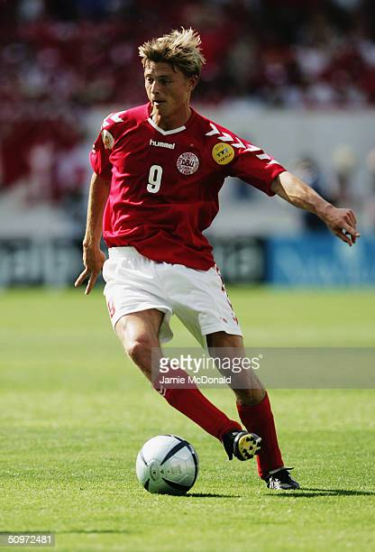Jon Dahl Tomasson of Denmark in action during the UEFA Euro 2004 Group C match between Denmark and Italy at the DAlfonso Henriques Stadium on June 14...