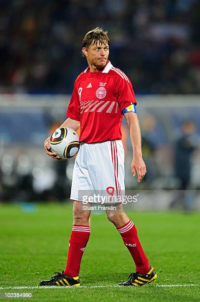 Jon Dahl Tomasson of Denmark leaves the pitch dejected after being knocked out of the competition during the 2010 FIFA World Cup South Africa Group E...