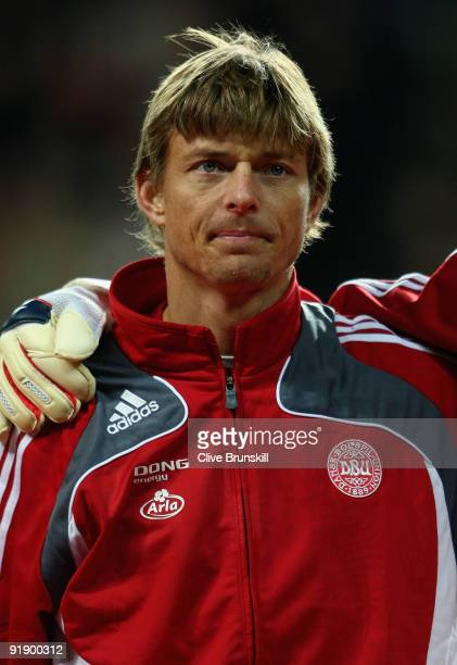 Jon Dahl Tomasson of Denmark stands for the national anthem during the FIFA 2010 group one World Cup Qualifying match between Denmark and Hungary at...