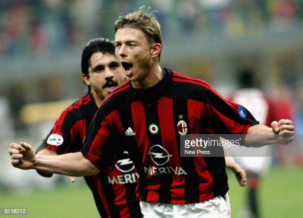 Jon Dahl Tomasson of Milan celebrates during the Serie A match between AC Milan and Parma held at Guiseppe Meazza San Siro on March 20 2004 in Milan...