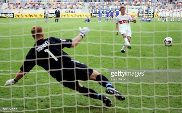 Jon Dahl Tomasson of Stuttgart scores the winning goal during the Premiere Liga Cup Match between Hertha BSC Berlin and VFB Stuttgart at the LTU...