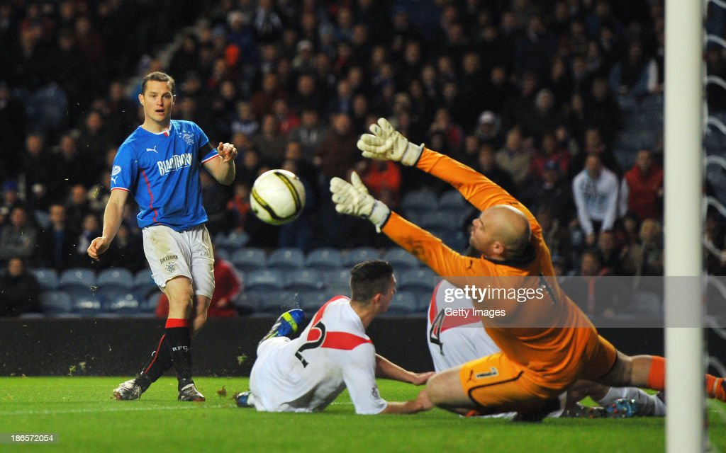 Jon Daly of Rangers scores the first goal during the The William Hill Scottish Cup Third Round match between Rangers and Airdrieonians at Ibrox Stadium on November 1, 2013 in Glasgow, Scotland.