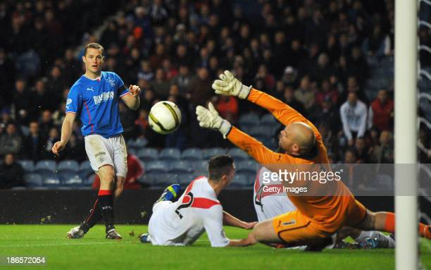 Jon Daly of Rangers scores the first goal during the The William Hill Scottish Cup Third Round match between Rangers and Airdrieonians at Ibrox...