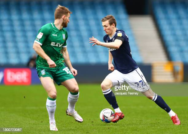 Jon Daoi Boovarsson of Millwall FC is put under pressure by Tom Lees of Sheffield Wednesday during the Sky Bet Championship match between Millwall...