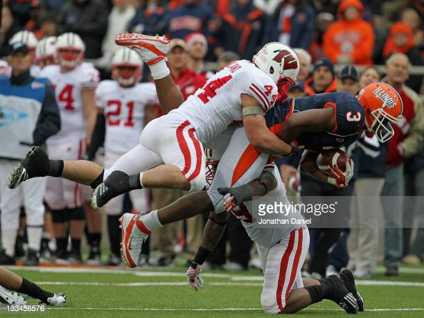 Jon Davis of the Illinois Fighting Illini is hit by Chris Borland and Kevin Claxton of the Wisconsin Badgers at Memorial Stadium on November 19 2011...