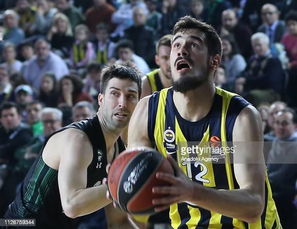Jon Diebler of Darussafaka Tekfen in action against Nikola Kalinic of Fenerbahce Beko during Turkish Airlines Week 23 basketball match between...