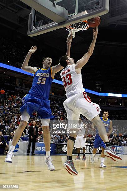 Jon Diebler of the Ohio State Buckeyes goes for a reverse layup in the second half against Greg Somogyi of the UC Santa Barbara Gauchos during the...