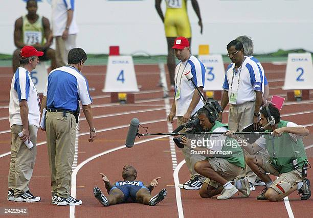 Jon Drummond of USA protest his innocent to a false start during the men's 100m quarter final at the 9th IAAF World Athletics Championship August 24,...
