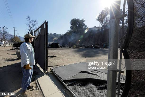 Jon Eck stands near his gate that firefighters knocked down while looking over his burnedout workshop following the Creek fire in SunlandTujunga on...