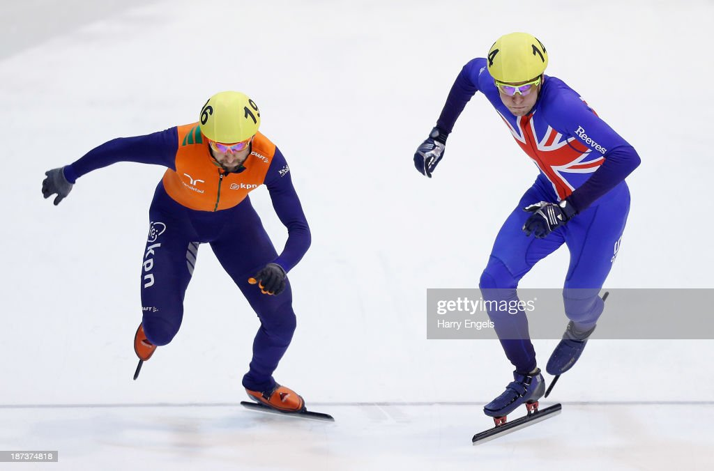 Jon Eley of Great Britain (R) and Niels Kerstholt of the Netherlands race off from the start during the Men's 5000m relay heats on day two of the Samsung ISU Short Track World Cup at the Palatazzoli on November 8, 2013 in Turin, Italy.