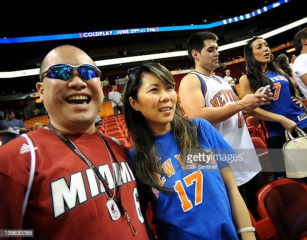 Jon Eng proudly wears his LeBron James jersey alongside his wife Alice Eng who wears her Jeremy Lin jersey as the Miami Heat plays host to the New...