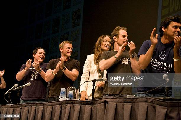 Jon Favreau Daniel Craig Olivia Wilde and and Sam Rockwell speak at the Cowboys and Aliens panel at ComicCon on July 24 2010 in San Diego California